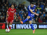 Ipswich player Daryl Murphy shoots to open the scoring during the Sky Bet Championship match between Cardiff City and Ipswich Town at Cardiff City Stadium on October 21, 2014
