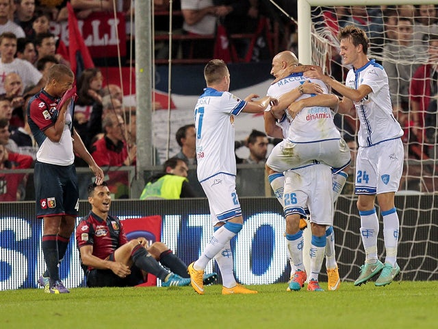 Empoli FC players celebrate a goal scored by Lorenzo Tonelli #26 during the Serie A match between Genoa CFC and Empoli FC at Stadio Luigi Ferraris on October 20, 2014