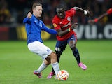 Idrissa Gueye of Lille evades Aidan McGeady of Everton during the UEFA Europa League Group H match between LOSC Lille and Everton at Grand Stade Lille Metropole on October 23, 2014