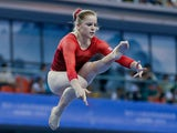 Gabrielle Jupp of Great Britain performs on the Balance Beam during the women's qualification of the 45th Artistic Gymnastics World Championships at Guangxi Sports Center Stadium on October 6, 2014