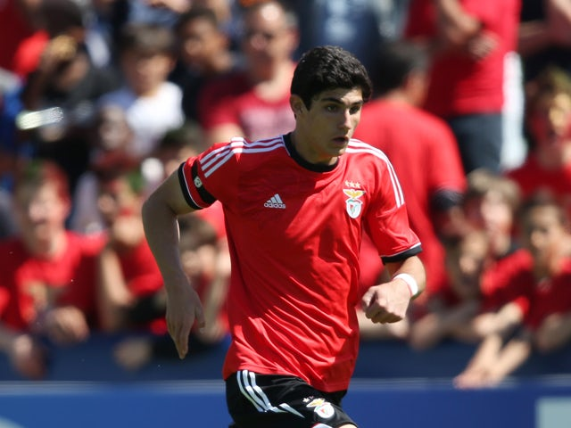 Goncalo Guedes of SL Benfica runs with the ball during the UEFA Youth League Semi Final match between Real Madrid and Benfica Lisbon at Colovray Stadion on April 11, 2014