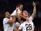 Emil Hallfredsson of Verona celebrates the opening goal during the Serie A match between SSC Napoli and Hellas Verona FC at Stadio San Paolo on October 26, 2014