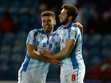 Jacob Butterfield of Huddersfield celebrates scoring the opening goal with Tommy Smith during the Sky Bet Championship match against Brighton on October 21, 2014