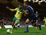 Jason Pearce of Leeds United battles with Josh Murphy of Norwich City during the Sky Bet Championship match on October 21, 2014