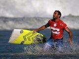 Australian Joel Parkinson runs with his broken surfboard during the Billabong Rio Pro surf tournament at Barra de Tijuca beach in Rio de Janeiro on May 12, 2014