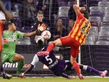 Lens' French midfielder Alharbi El Jadeyaoui scores a goal past Toulouse's French goalkeeper Zacharie Boucher during the French first division football match Toulouse FC vs RC Lens at the Municipal Stadium in Toulouse on October 24, 2014