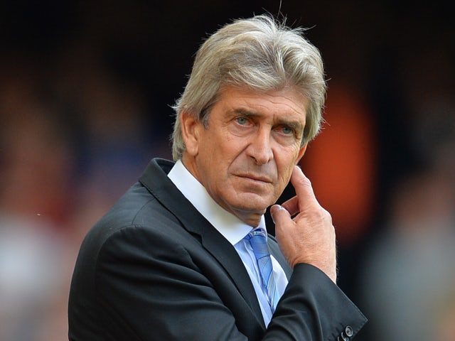 Manchester City's Chilean manager Manuel Pellegrini watches the action during the English Premier League football match between West Ham United and Manchester City at Upton Park in London on February 11, 2014