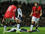 Manchester United's Dutch midfielder Daley Blind celebrates scoring their second goal during the English Premier League football match between West Bromwich Albion and Manchester United at The Hawthorns in West Bromwich, central England on October 20, 201