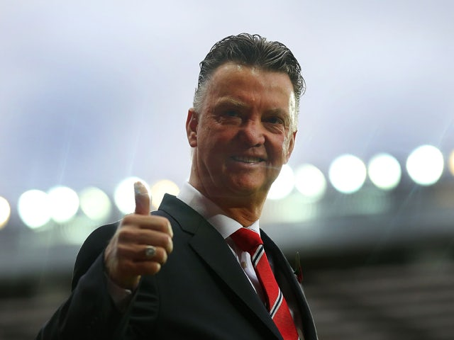 Manchester United Manager Louis van Gaal gives a thumbs up prior to the Barclays Premier League match between Manchester United and Chelsea at Old Trafford on October 26, 2014