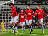 Manchester United's Belgian midfielder Marouane Fellaini celebrates scoring their first goal as West Bromwich Albion's US-born Welsh goalkeeper Boaz Myhill reacts during the English Premier League football match between West Bromwich Albion and Manchester