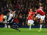 Marouane Fellaini of Manchester United shoots past Sebastien Pocognoli of West Bromwich Albion to score their first and equalising goal during the Barclays Premier League match between West Bromwich Albion and Manchester United at The Hawthorns on October