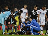 Marseille's Ivoirian defender Brice Dja Djedje lies on the pitch after being injured during the French L1 football match Olympique Lyonnais (OL) vs Marseille (OM) on October 26, 2014