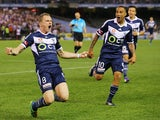 Besart Berisha of the Victory celebrates a goal with Archie Thompson during the round three A-League match between the Melbourne Victory and Melbourne City at Etihad Stadium on October 25, 2014