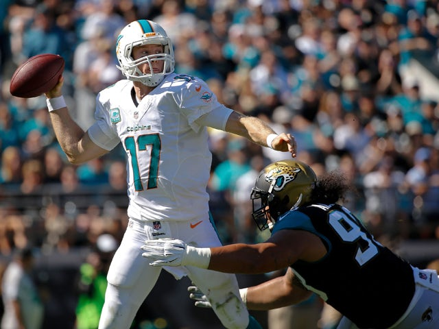 Ryan Tannehill #17 of the Miami Dolphins is pressued by Tyson Alualu #93 of the Jacksonville Jaguars during the second quarter of the game at EverBank Field on October 26, 2014