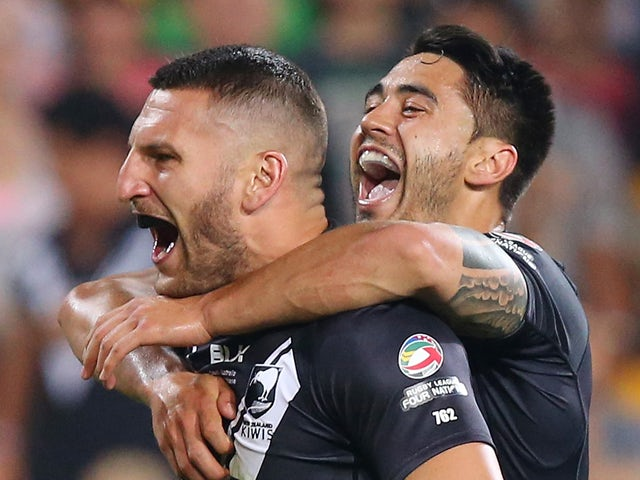 Lewis Brown of New Zealand celebrates a try with team mates during the Four Nations Rugby League match between the Australian Kangaroos and New Zealand Kiwis at Suncorp Stadium on October 25, 2014