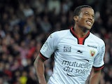 Nice's French forward Alassa Plea celebrates after scoring during the French L1 football match Guingamp vs Nice on October 26, 2014