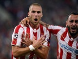 Olympiacos Pajtim Kasami celebrates after scoring a goal during the Group A Champions League football match Olympiacos vs Juventus at the Karaiskaki stadium in Athens' Piraeus district on October 22, 2014