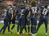Paris Saint-Germain's Brazilian midfielder Lucas Moura is congratulated by Paris Saint-Germain's Brazilian defender Maxwell and team mates after he scored a goal during a French L1 football match between Paris Saint-Germain and Bordeaux at the Parc des Pr