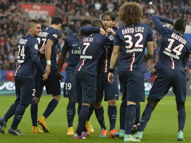 Paris Saint-Germain's Brazilian midfielder Lucas Moura is congratulated by Paris Saint-Germain's Brazilian defender Maxwell and team mates after he scored a goal during a French L1 football match between Paris Saint-Germain and Bordeaux at the Parc des Pr