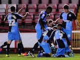 Peter Murphy of Wycombe Wanderers (R) celebrates scoring his side's first goal during the Sky Bet League Two match between Exeter City on October 21, 2014