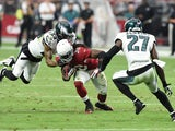 Running back Andre Ellington #38 of the Arizona Cardinals runs the ball against cornerback Nolan Carroll #23 and free safety Malcolm Jenkins #27 of the Philadelphia Eagles in the first quarter of the NFL game at University of Phoenix Stadium on October 26