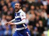 Glenn Murray of Reading celebrates after scoring the opening goal of the game during the Sky Bet Championship match between Reading and Blackpool at Madejski Stadium on October 25, 2014