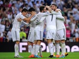 Real Madrid players celebrate after scoring their third goal against Barcelona in La Liga's El Clasico on October 25, 2014