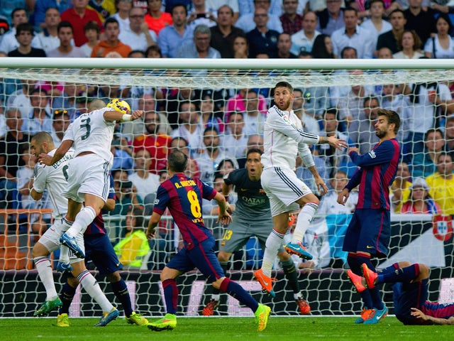 Pepe of Real Madrid CF heads in their second goal during the La Liga match between Real Madrid CF and FC Barcelona at Estadio Santiago Bernabeu on October 25, 2014