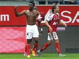 Reims' forward Benjamin Moukandjo celebrates after scoring during the French L1 football match between Reims (SR) and Montpellier (MHSC) in Reims, northern France on October 25, 2014
