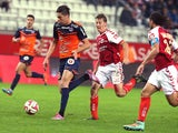Reims' French defender Franck Signorino vies with Montpellier's French midfielder Jonas Martin during the French L1 football match Reims vs Montpellier, on October 25, 2014