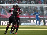 Rennes' French midfielder Abdoulaye Doucoure is congratulated by Rennes' Switss midfielder Gelson Fernandez after scoring a goal during the French L1 football match between Rennes (SRFC) and Lille (LOSC) on October 26, 2014