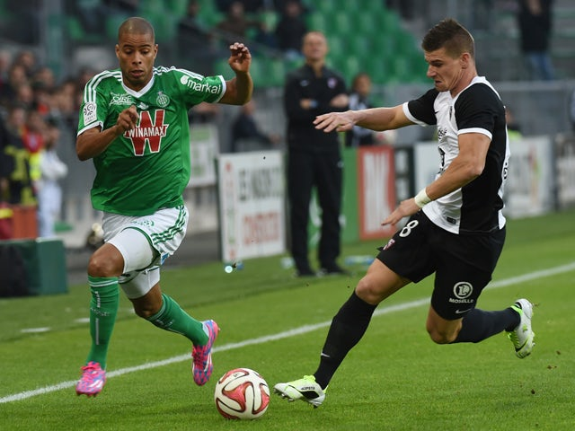 Saint-Etienne's French forward Kevin Monnet-Paquet (L) vies for the ball with Metz' French defender Jeremy Choplin during the French L1 football match between AS Saint-Etienne and FC Metz, on October 26, 2014