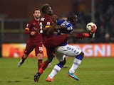 Stefano Chuka Okaka of UC Sampdoria is challenged by Mapou Yanga-Mbiwa of AS Roma during the Serie A match between UC Sampdoria and AS Roma at Stadio Luigi Ferraris on October 25, 2014