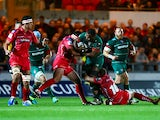 Vereniki Goneva of Leicester Tigers crashes into Michael Tagicakibau of Scarlets during the European Rugby Champions Cup match between Scarlets and Leicester Tigers at Parc y Scarlets on October 25, 2014