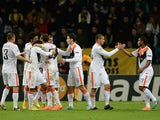 Shakhtar Donetsk's players celebrate after scoring a goal during the UEFA Champions League group H football match against BATE on October 21, 2014