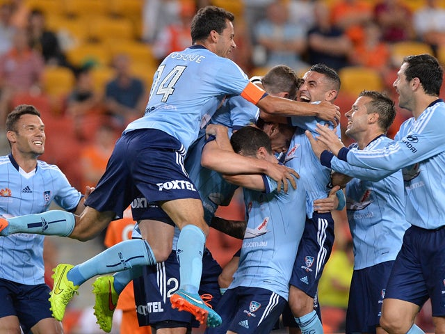 Marc Janko of Sydney is congratulated by team mates after scoring a goal during the round three A-League match between Brisbane Roar and Sydney FC at Suncorp Stadium on October 24, 2014