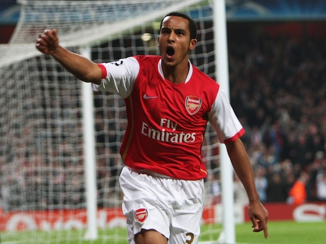 Theo Walcott of Arsenal celebrates his second goal and Arsenal's fifth during the UEFA Champions League Group H match between Arsenal and Slavia Prague on October 23, 2007