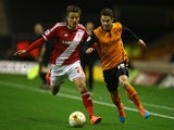Tommy Rowe of Wolverhampton Wanderers tangles with Jelle Vossen of Middlesbrough during the Sky Bet Championship match on October 21, 2014