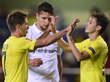 Villarreal's Argentinian forward Luciano Dario Vietto celebrates his goal with Villarreal's midfielder Javier Espinosa during the UEFA Europa League football match Villarreal CF vs FC Zurich at El Madrigal stadium in Villareal on October 23, 2014