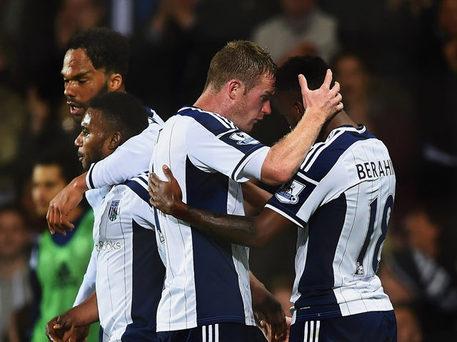 Saido Berahino of West Bromwich Albion celebrates with team mate Chris Brunt as he scores their second goal during the Barclays Premier League match between West Bromwich Albion and Manchester United at The Hawthorns on October 20, 2014