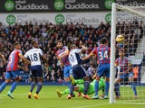 Victor Anichebe of West Brom scores the first goal during the Barclays Premier League match between West Bromwich Albion and Crystal Palace at The Hawthorns on October 25, 2014