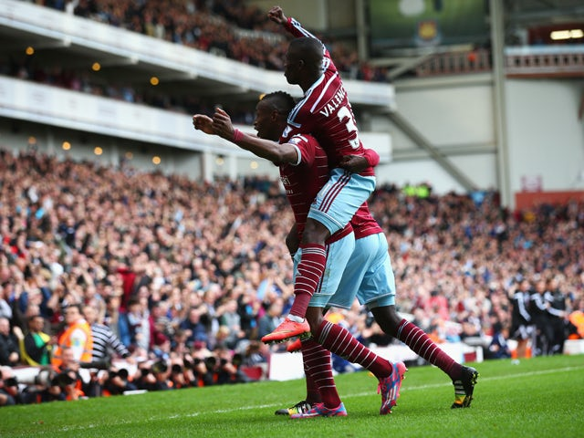 Diafra Sakho of West Ham United celebrates scoring his team's second goal with Enner Valencia of West Ham United during the Barclays Premier League match between West Ham United and Manchester City at Boleyn Ground on October 25, 2014
