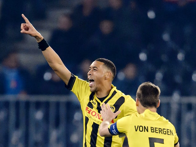 Young Boys' French forward Guillaume Hoarau gestures as he celebrates his team's first goal with teammate Swiss defender Steve von Bergen during the UEFA Europa League Group I football match between BSC Young Boys and SSC Napoli in Bern on October 23, 201