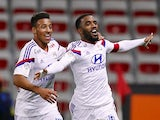 Lyon's French forward Alexandre Lacazette (R) celebrates with Lyon's French midfielder Corentin Tolisso (L) after scoring a goal during the French first division L1 football match against Nice on November 1, 2014