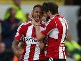 Andre Gray of Brentford celebrates with Jonathan Douglas of Brentford after he scores to make it 1-1 during the Sky Bet Championship match against Derby on November 1, 2014