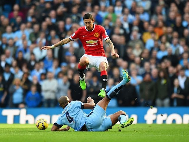 Angel di Maria of Manchester United leaps over a challenge from Vincent Kompany of Manchester City during the Barclays Premier League match at the Etihad on November 2, 2014
