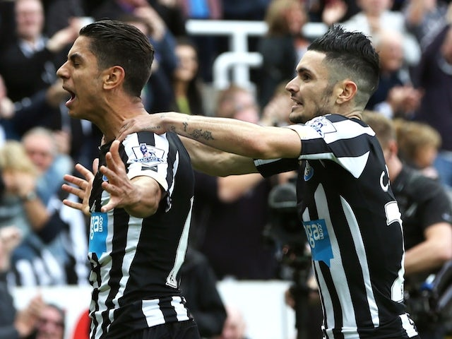 Newcastle United's Spanish striker Ayoze Perez (L) celebrates scoring the opening goal with Newcastle United's French midfielder Remy Cabella (R) during the English Premier League football match against Liverpool on November 1, 2014