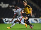 Ben Davies of Sheffield United looks to the ball with Samir Carruthers of MK Dons during the Capital One Cup Fourth Round match on October 28, 2014