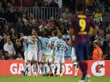 Celta Vigo's players celebrate after scoring during the Spanish league football match FC Barcelona vs RC Celta de Vigo at the Camp Nou stadium in Barcelona on November 1, 2014