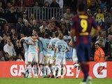 Celta Vigo's players celebrate after scoring during the Spanish league football match FC Barcelona vs RC Celta de Vigo at the Camp Nou stadium in Barcelona on November 1, 2014